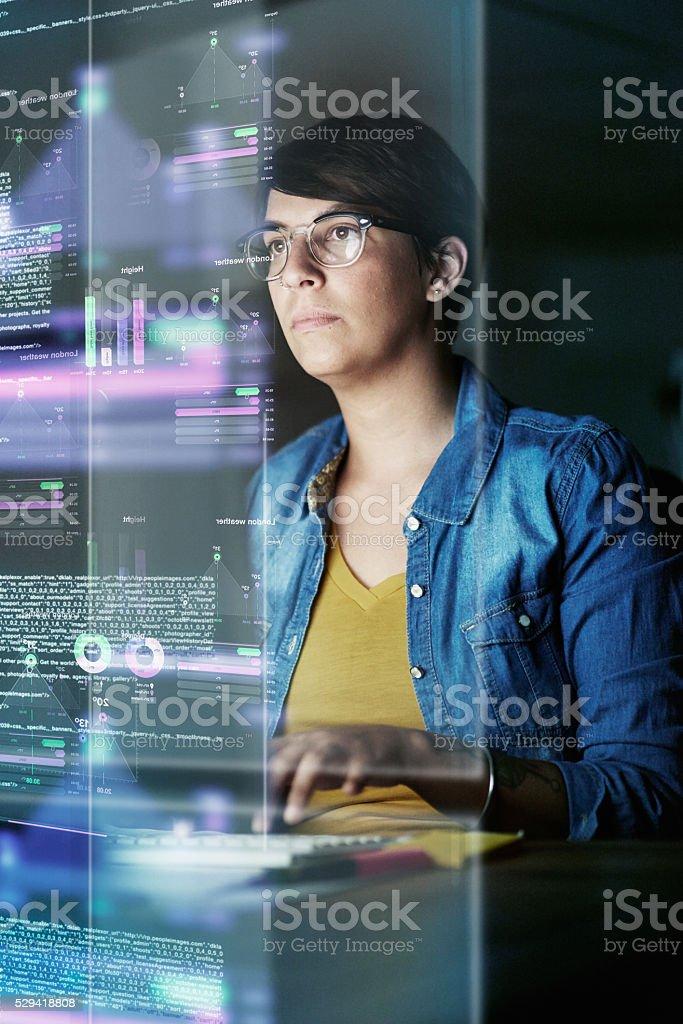 She's developing advanced code stock photo