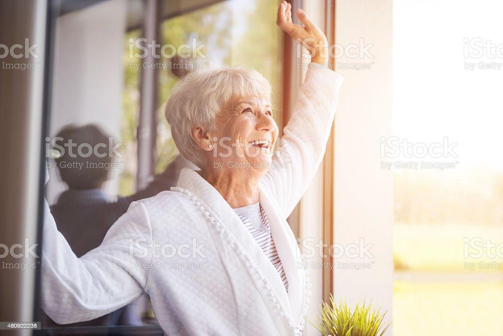 She's enjoying the beautiful day stock photo