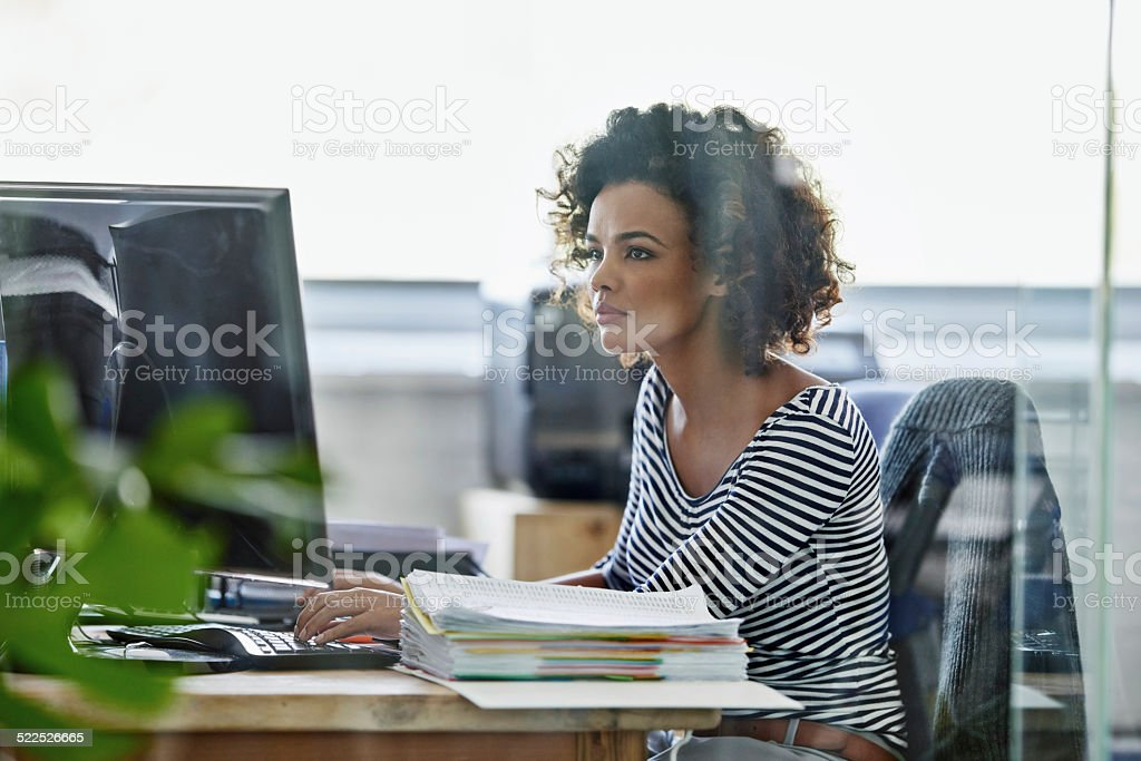 She's getting her work done stock photo