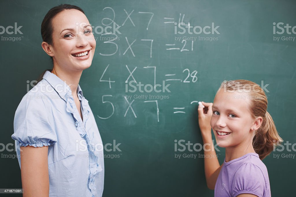 She's getting so good at her sums! stock photo