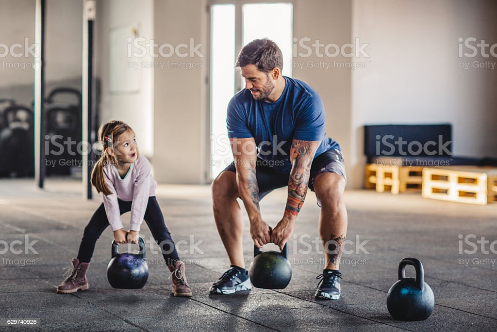 She's gonna be strong like daddy stock photo
