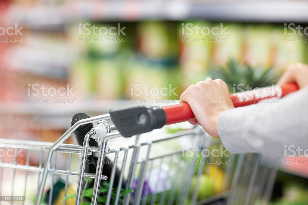 She's got a firm grip on grocery shopping royalty-free stock photo