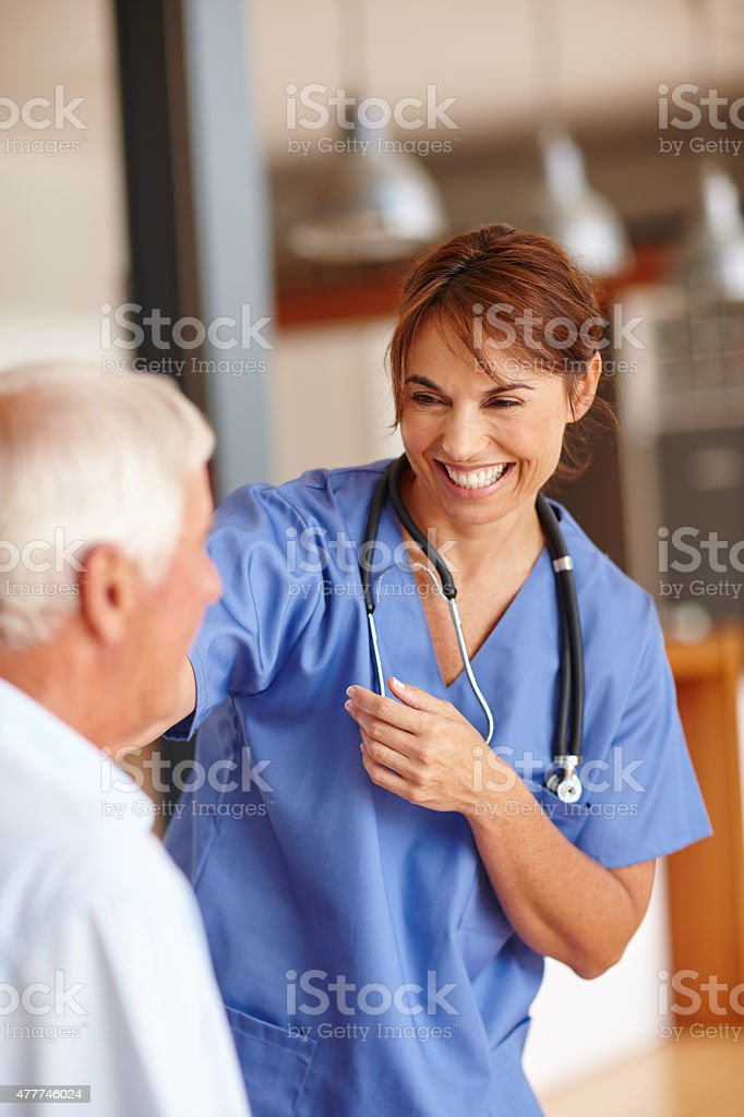 She's got an excellent bedside manner stock photo
