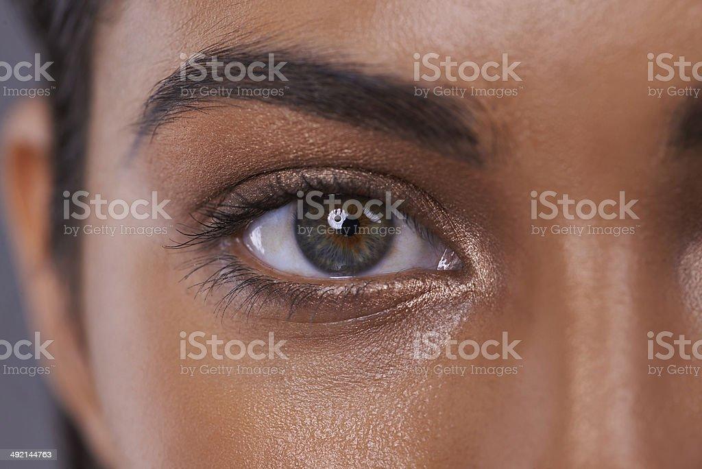 She's got her eye on beauty stock photo