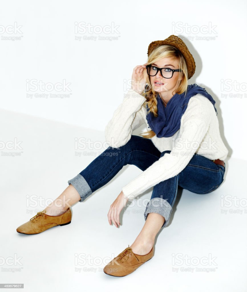 She's got her eye on the latest fashion trends stock photo
