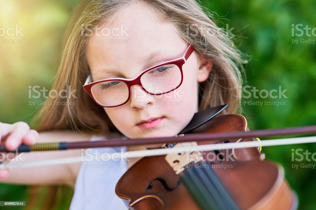 She's got natural-born musical talent stock photo