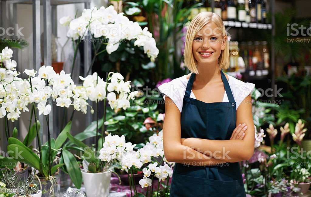 She's got the skills to nurture these plants stock photo