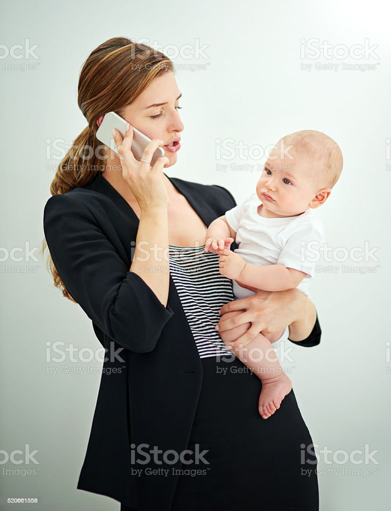 Shot of a successful young businesswoman carrying her adorable baby...
