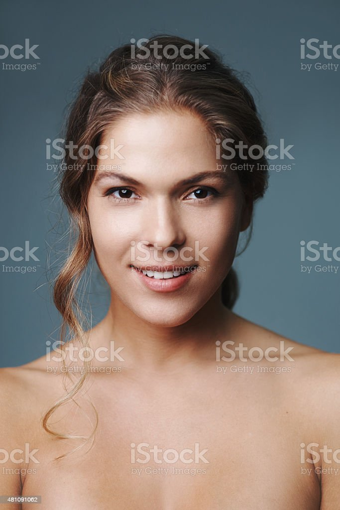 She's happy with her new skincare regime stock photo