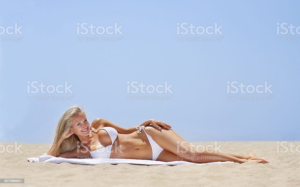 She's heating up the beach! stock photo