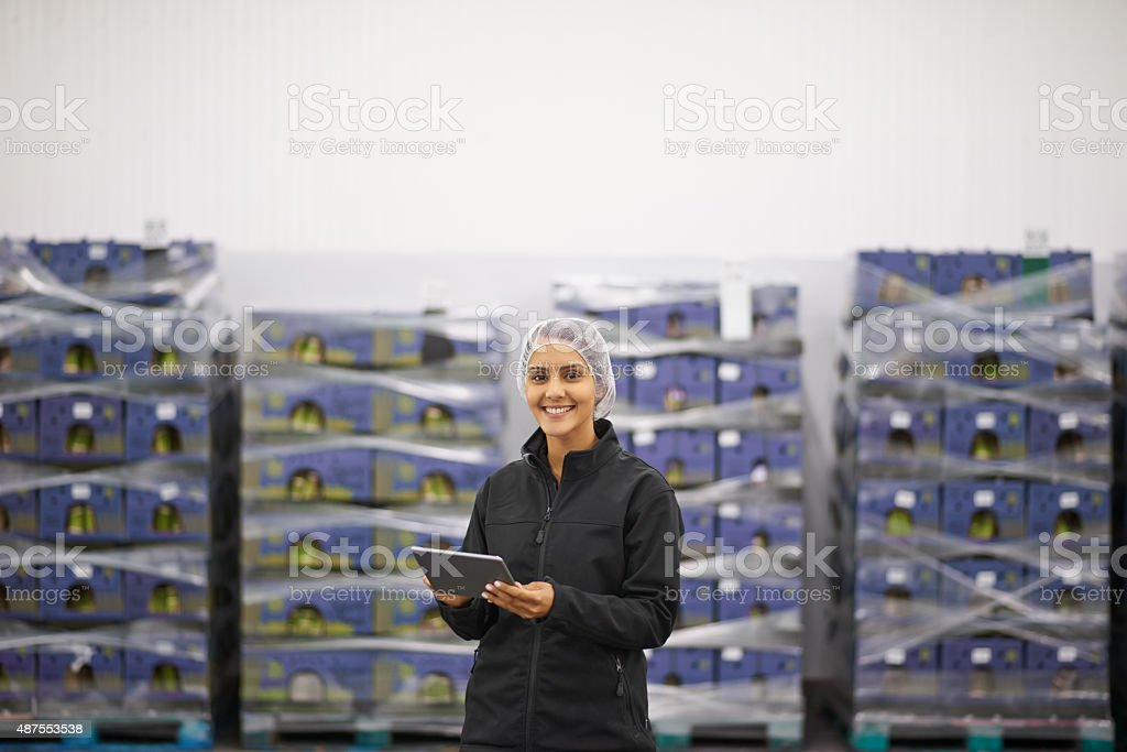 She's  in charge of stock control stock photo