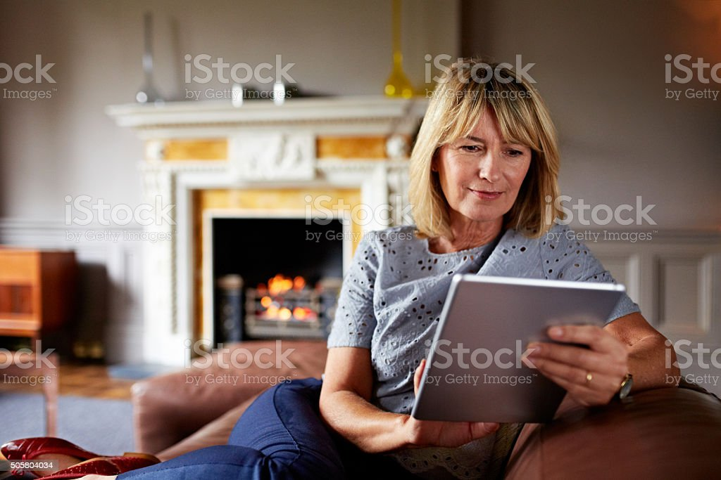 She's in touch with technology stock photo