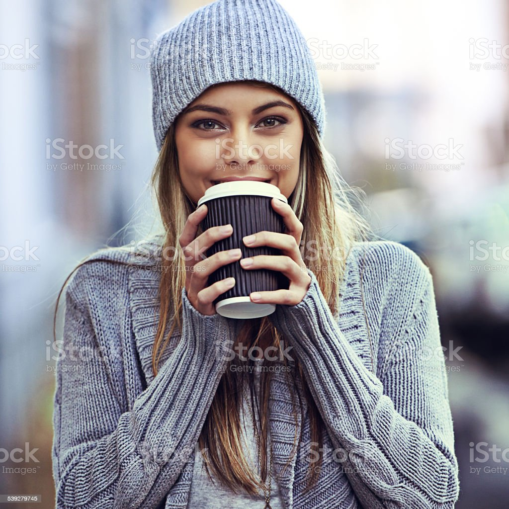 She's just been to her favorite coffee place stock photo
