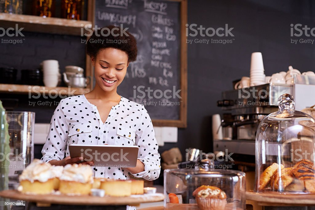 She's managing her business' homepage stock photo