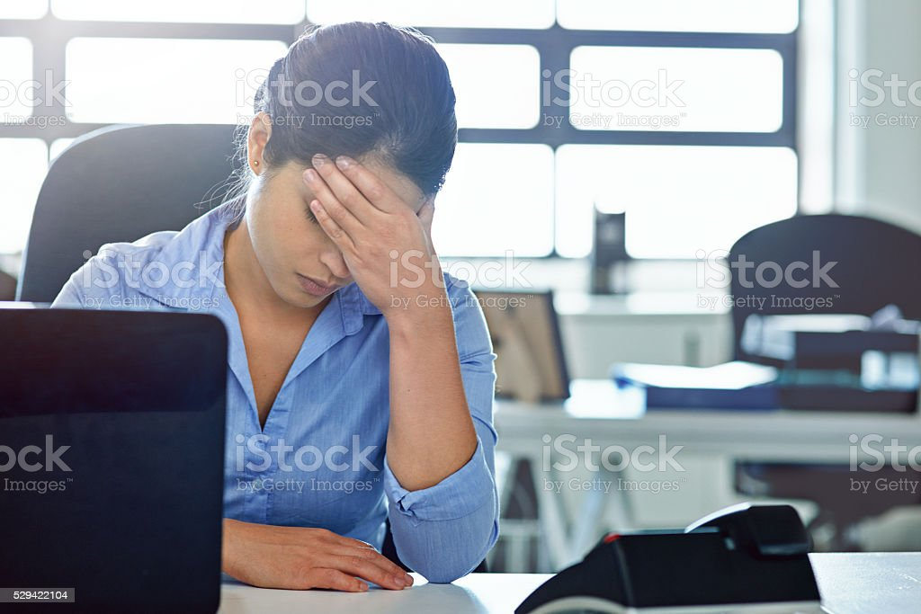 She's not handling the pressures of her job stock photo