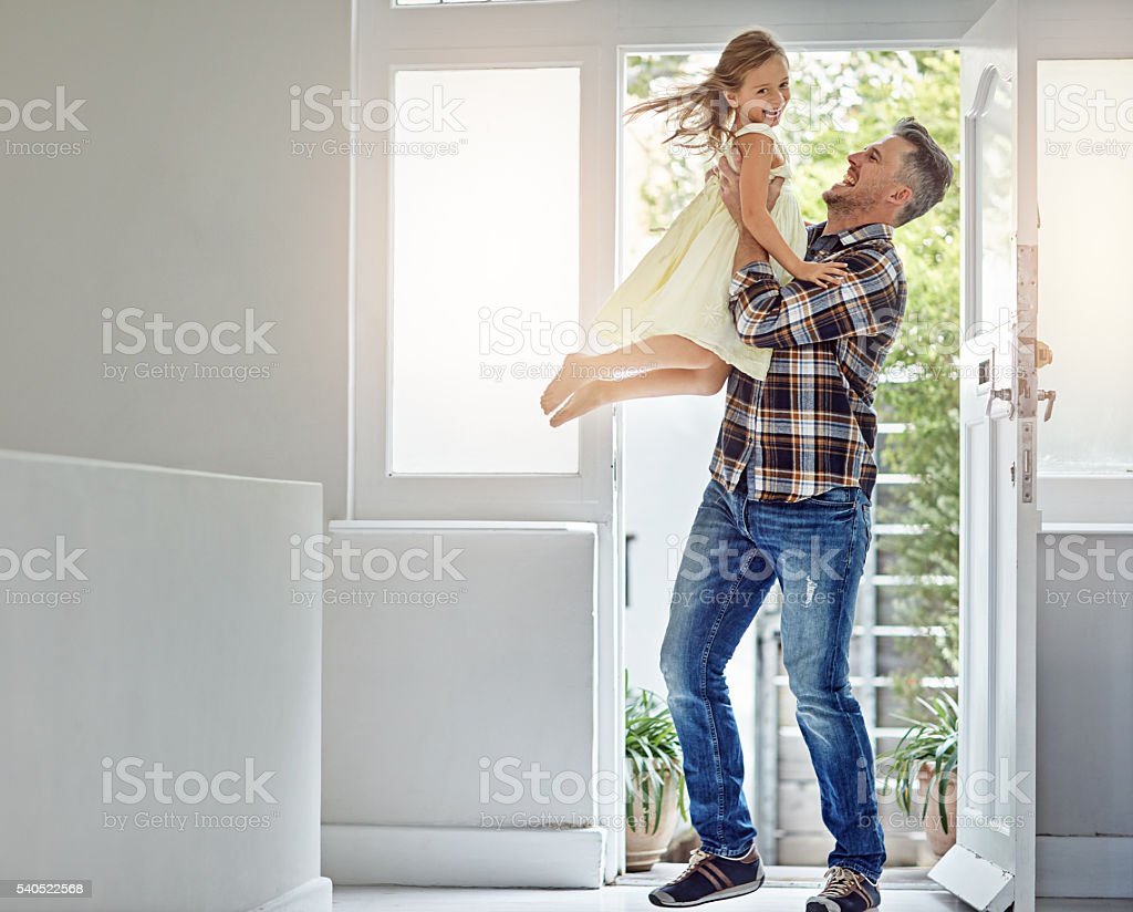 She's on cloud nine when dad gets home stock photo