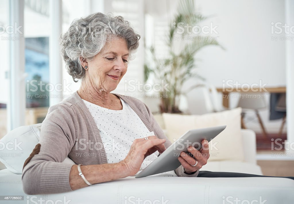 She's one up-to-date senior! stock photo