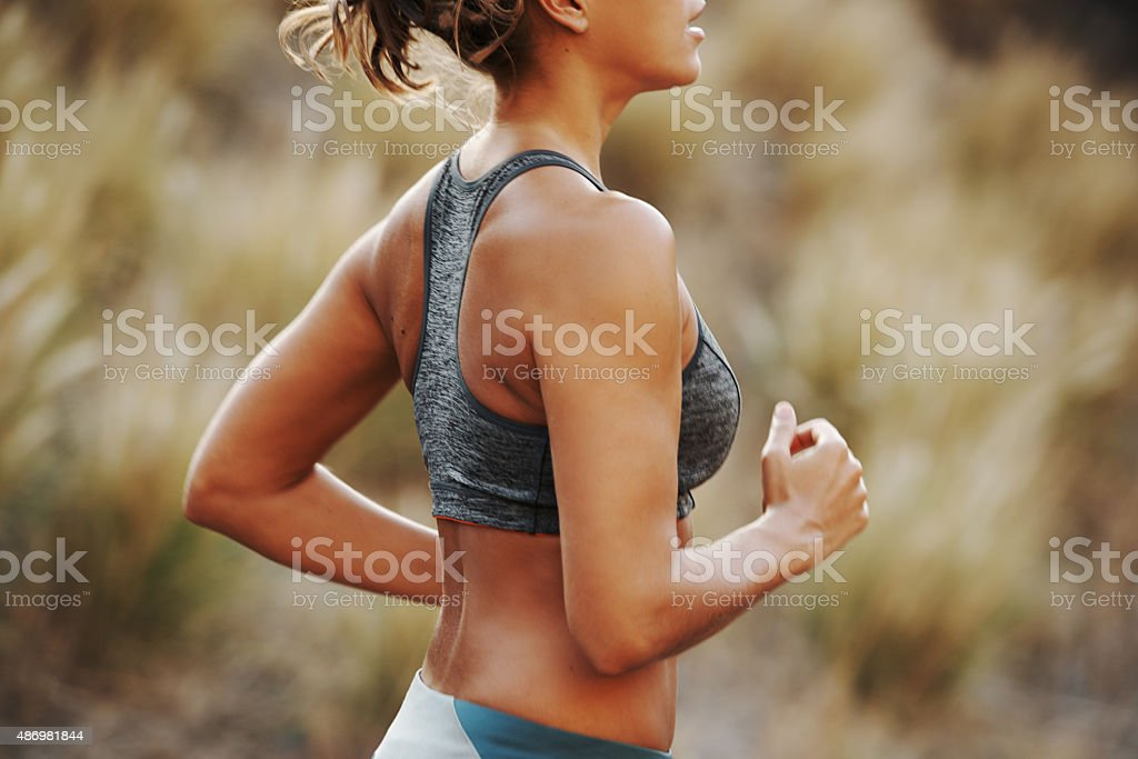 She's owning this run! stock photo