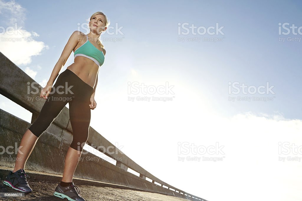 She's passionate about running on the road stock photo