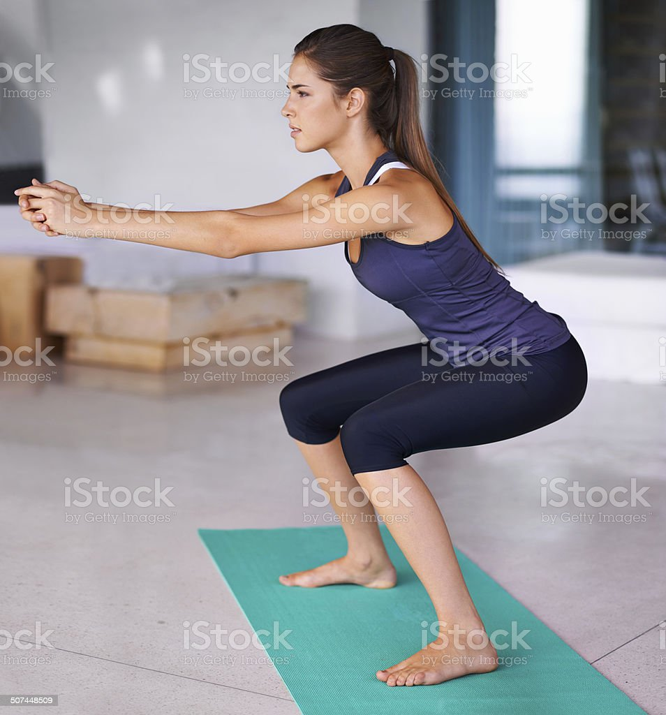 She's perfected the pilates pose stock photo
