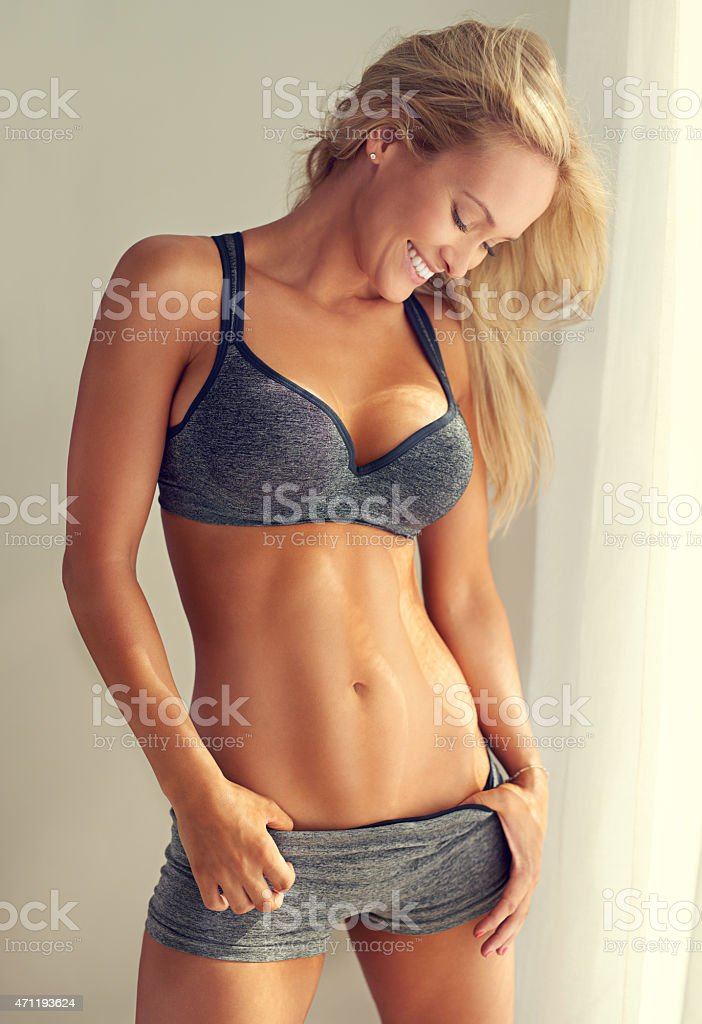 She's proud of her abs stock photo