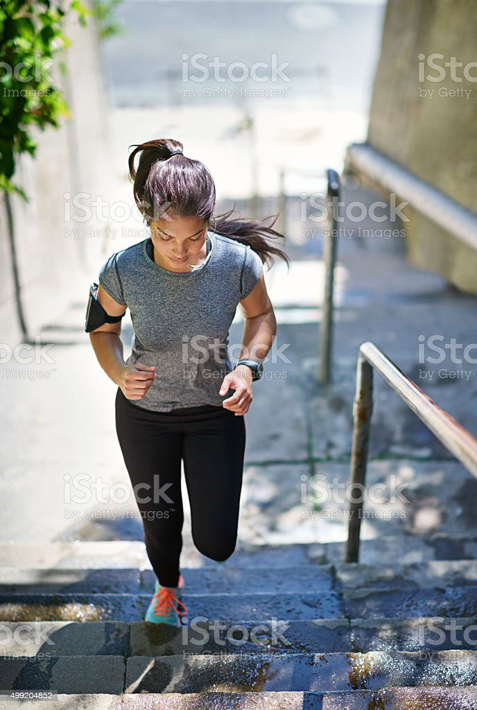 She's stepping up her fitness routine stock photo