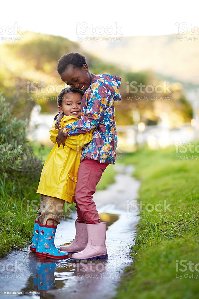 She's the best big sister ever! stock photo