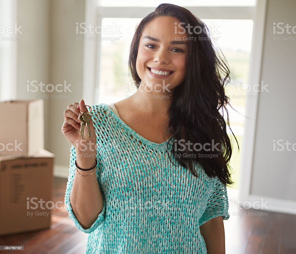 She's the proud new owner of this house stock photo