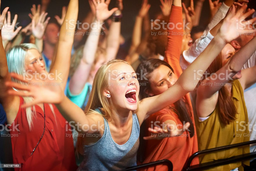 She's their biggest fan! stock photo
