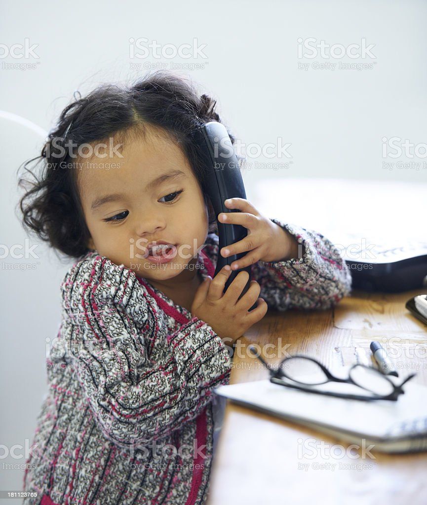 She's very professional for her age royalty-free stock photo
