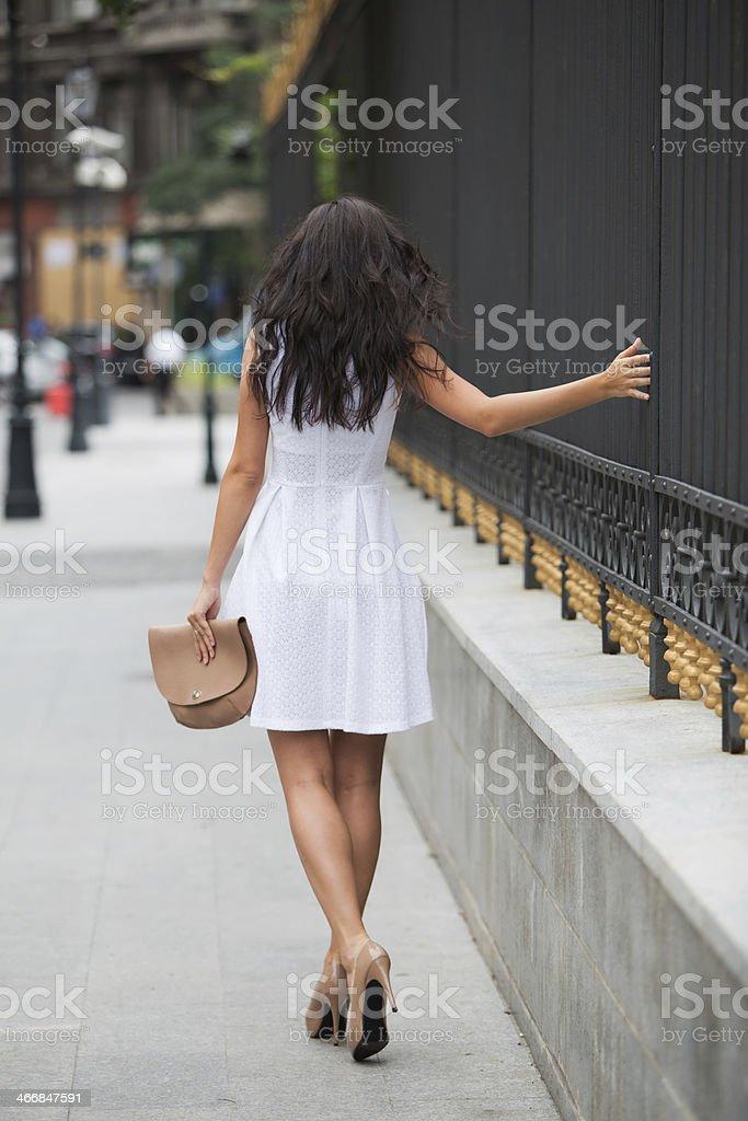 She's walking away royalty-free stock photo