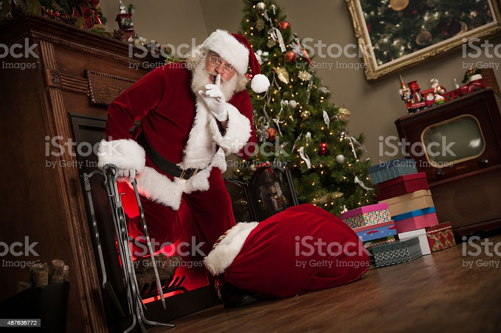 Shh Real Santa Climbing Out of The Fireplace stock photo