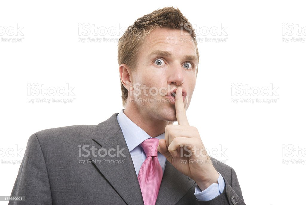 Shh! Says Businessman Holding Finger to Lips White Background royalty-free stock photo
