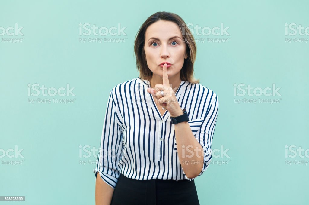 Shh sign. Anger businessperson. Angry boss. with beard and handlebar mustache looking at camera with silent sign. stock photo