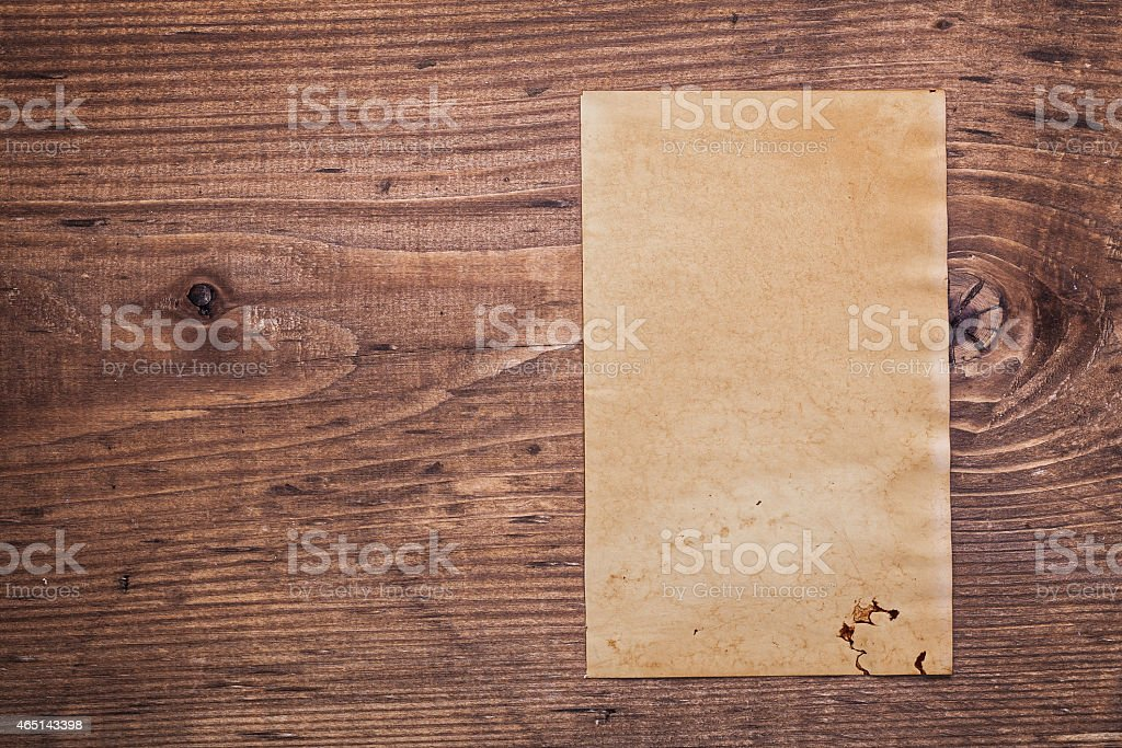 shhet of old paper on vintage wooden board with copyspace stock photo
