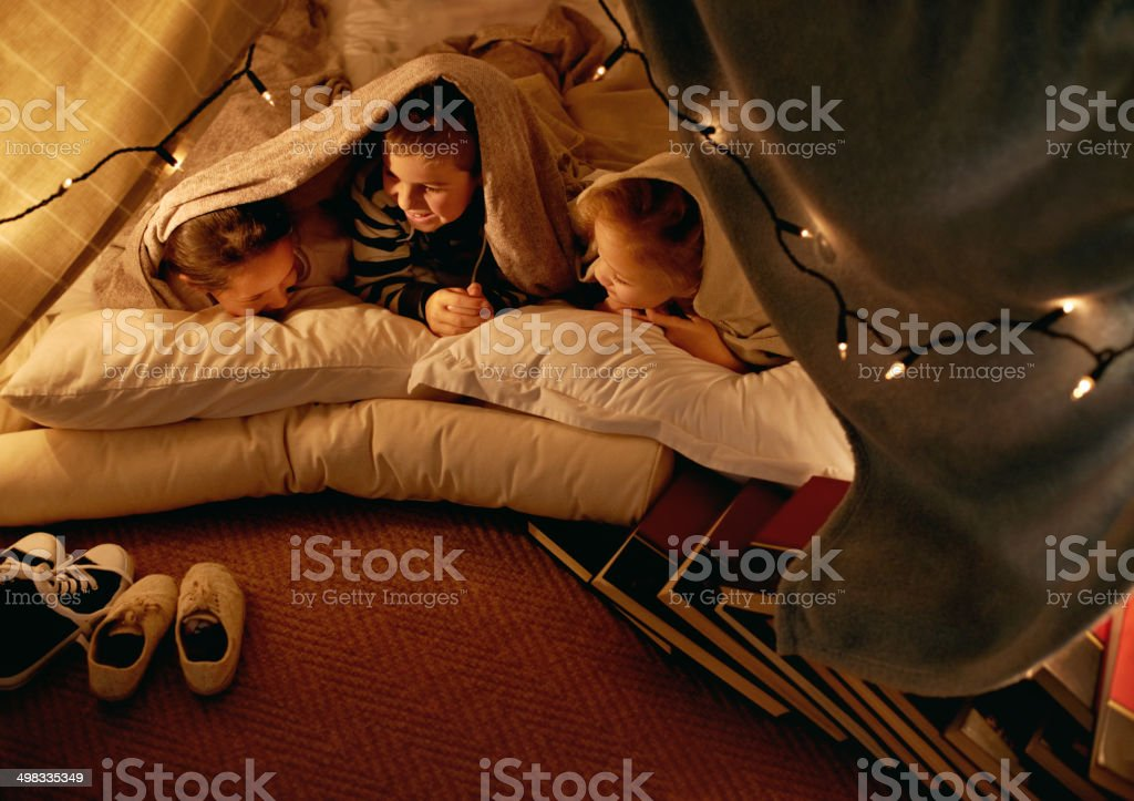 Shh...or mom will make us go to bed stock photo