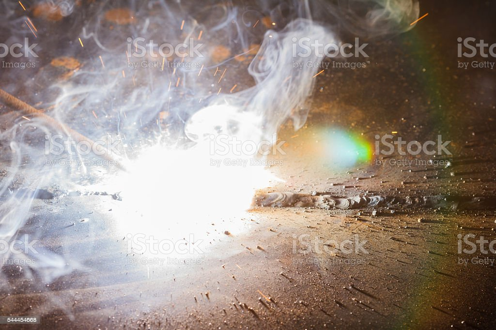 SMAW – Shielded matal arc welging and welding fumes stock photo