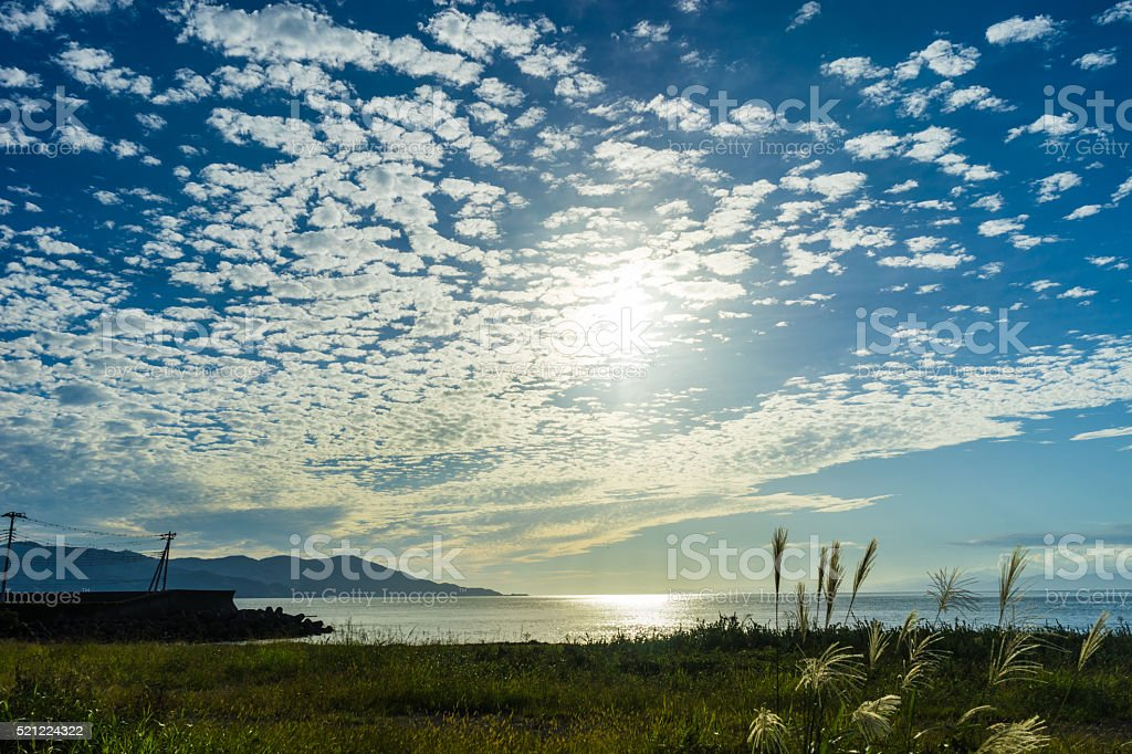 Shige shore and mackerel sky stock photo