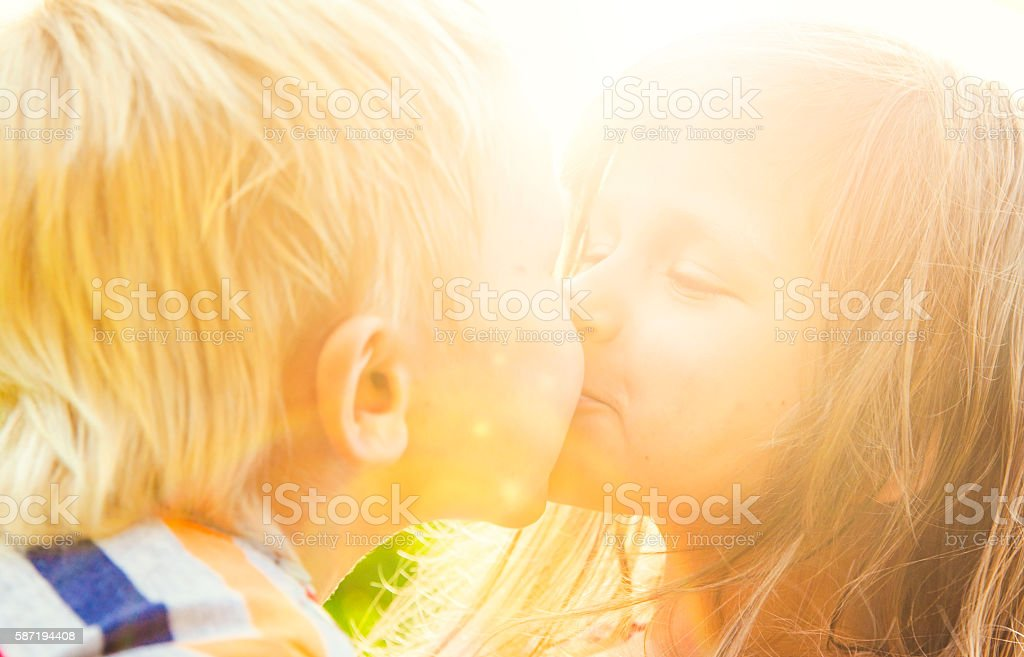 Сhildren kissing stock photo