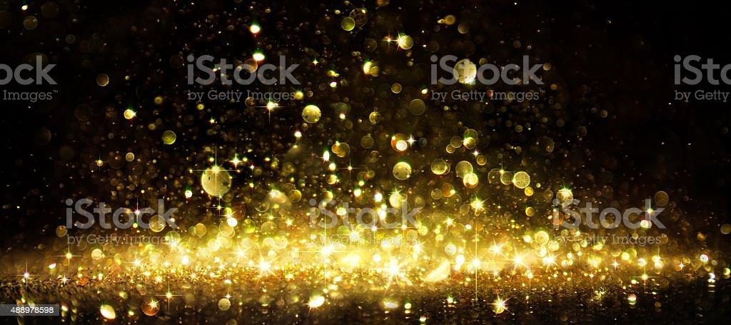 Shimmer Of Golden Glitter On Dark stock photo