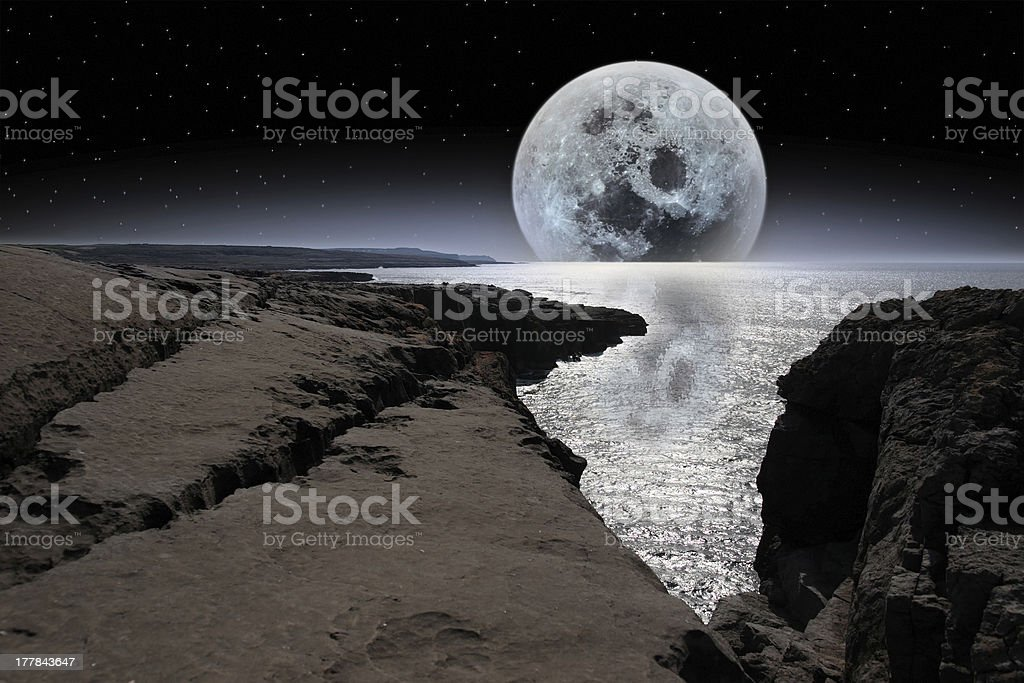 shimmering moon and boulders in rocky burren landscape royalty-free stock photo