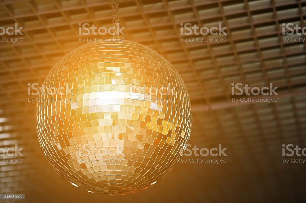 Shined disco mirror ball over the dance floor stock photo