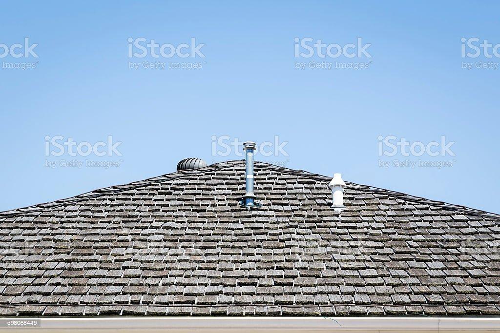 Shingled Roof against a Blue Sky stock photo