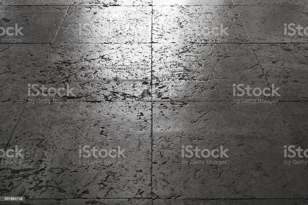 Shining gray stone floor tiling, background texture with perspective...