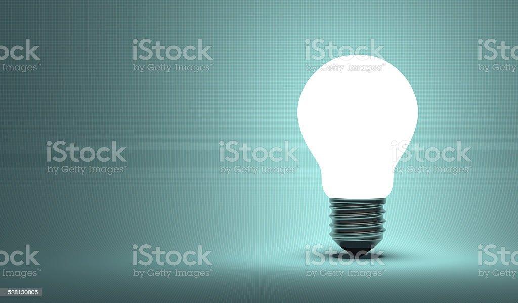 Shining arbitrary light bulb on blue stock photo