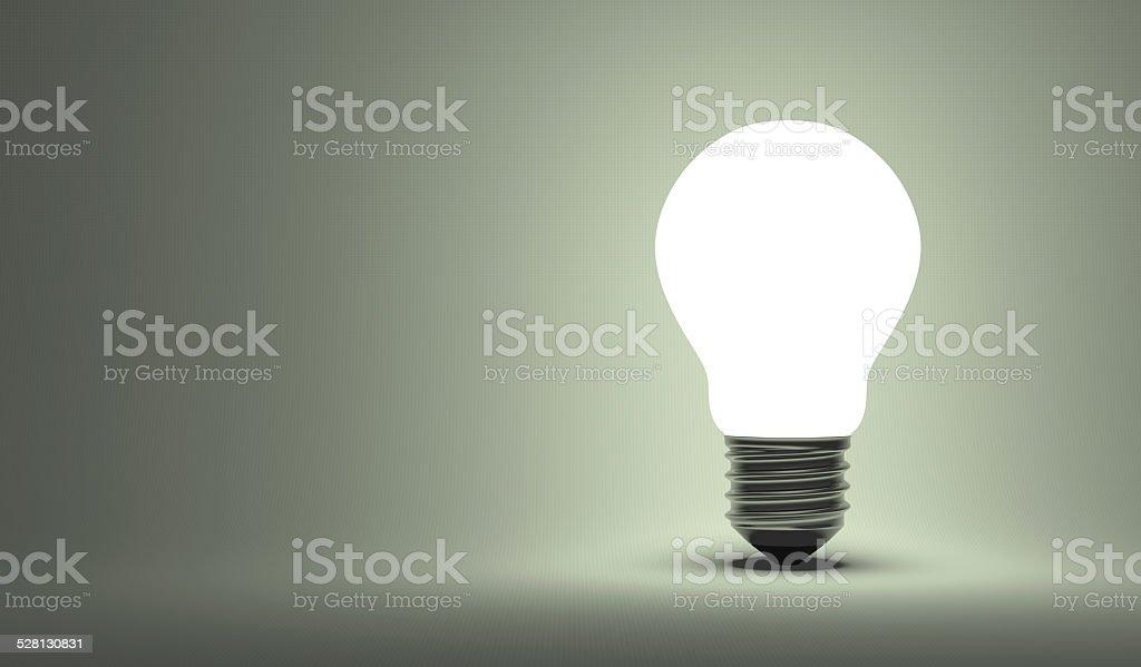 Shining arbitrary light bulb on gray stock photo