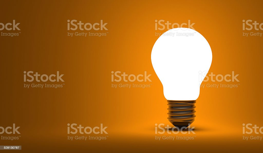 Shining arbitrary light bulb on orange stock photo