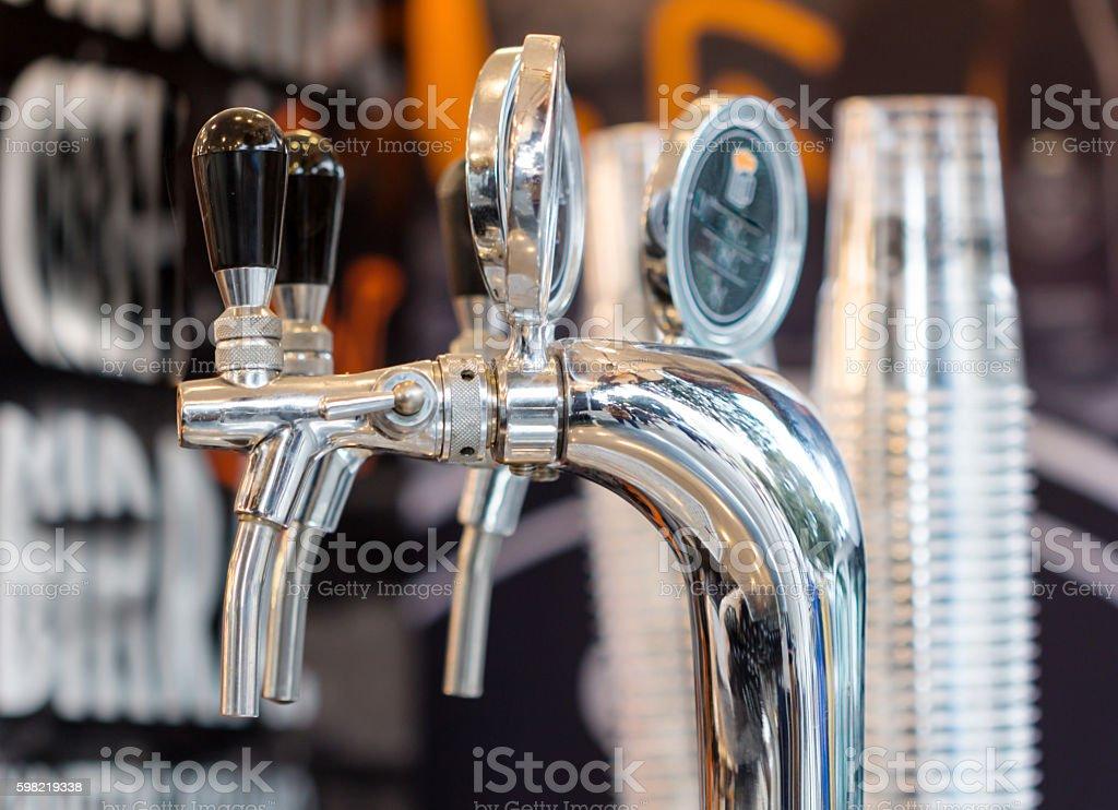 shining beer faucets in a bar / Metallic beer taps / Beer at restaurant stock photo