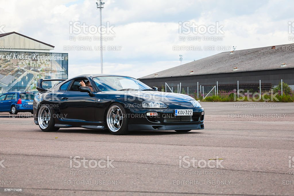 Shining black Toyota Supra A80 goes on street stock photo