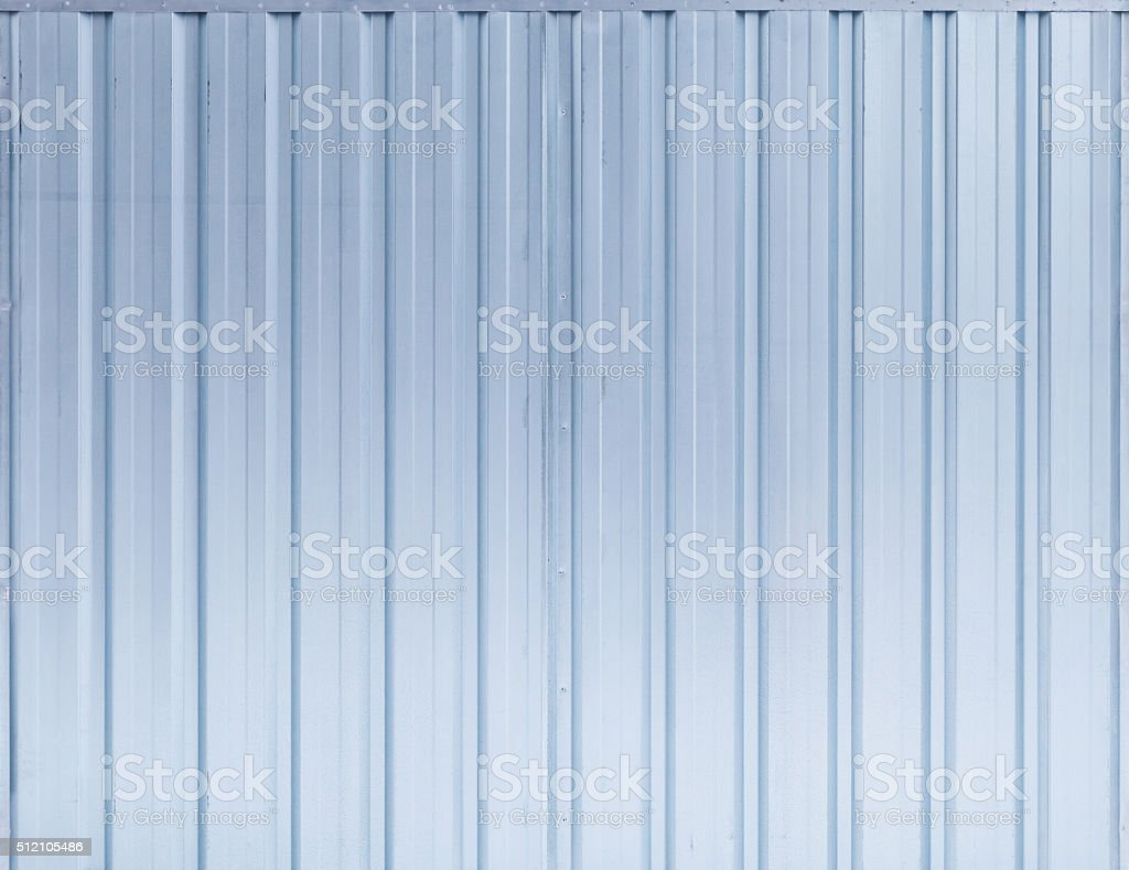Shining blue ridged steel wall, background texture stock photo